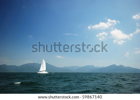 Sailing boat cruising through the sea