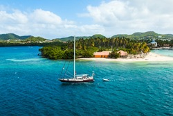 Sailing boat enters the bay of Martinique French Polynesia.