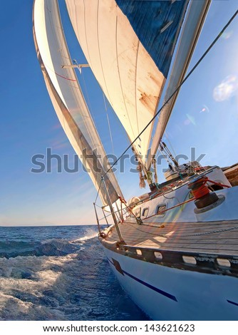 Sailing boat in blue open sea