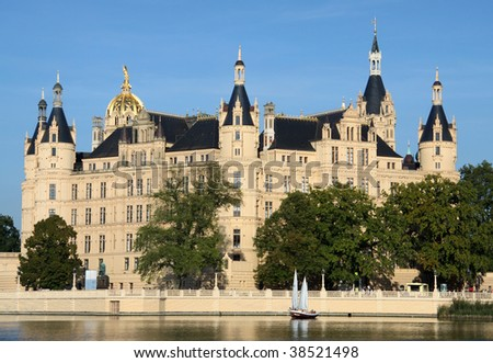 Sailing boat in front of the old castle of Schwerin (Germany)