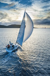 Sailing boat in light wind from bird`s eye view