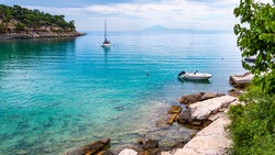 Sailing boat in the bay of the beautiful Aliki beach, Thassos island, Greece