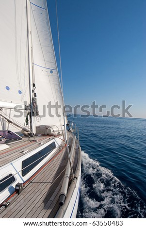 Sailing boat in the middle of the sea - stock photo