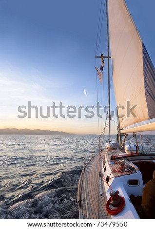 Sailing boat in the sea at the dawn