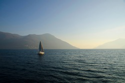 Sailing Boat on an Alpine Lake with Mountain in Switzerland.
