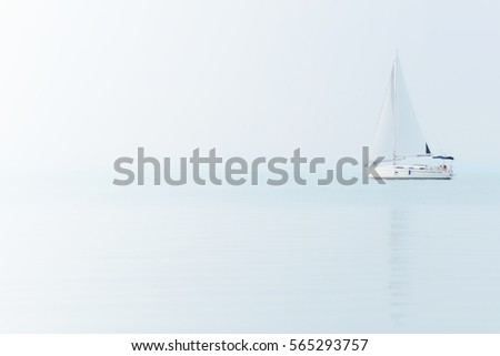 Sailing boat on Blue sea in Foggy Weather. Sailing Ship on The Lake Balaton.