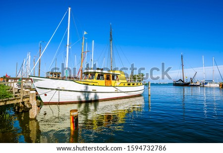 Sailing boat on sea water. Sailing boat at pier. Sailing boat. Sailing boat on water