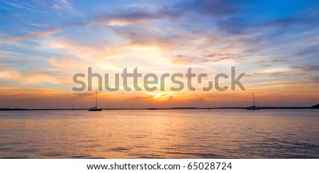 Sailing boat silhouette with sunset sky. Fernandina beach, Florida, USA #65028724