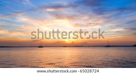 Sailing boat silhouette with sunset sky. Fernandina beach, Florida, USA