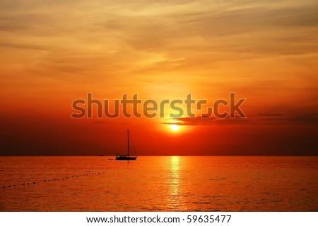sailing boat sunset at kata beach phuket #59635477