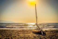 sailing boat sunset on the beach