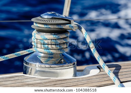 Sailing boat winch with rope closeup - stock photo