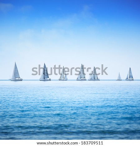 Sailing boat yacht or sailboat group regatta race on sea or ocean water. Panoramic view. #183709511