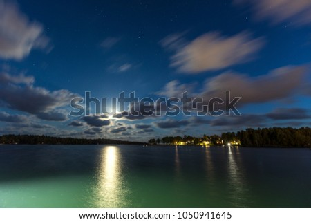 Sailing boats and yachts in marina at night with cloudy sky. Nynashamn. Sweden. #1050941645