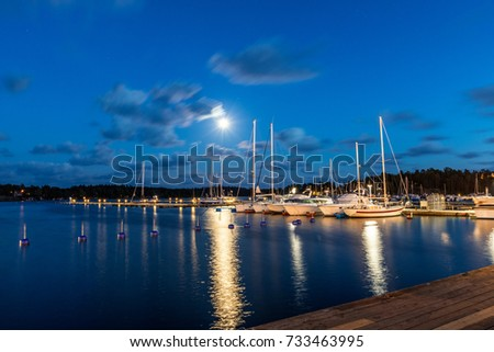 Sailing boats and yachts in marina at night with cloudy sky. Nynashamn. Sweden. #733463995