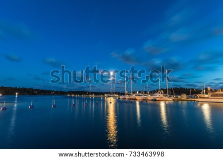 Sailing boats and yachts in marina at night with cloudy sky. Nynashamn. Sweden. #733463998