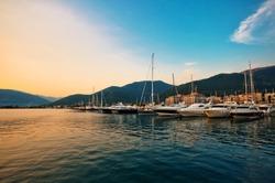 Sailing boats and yachts in marina at sunset. Tivat. Montenegro