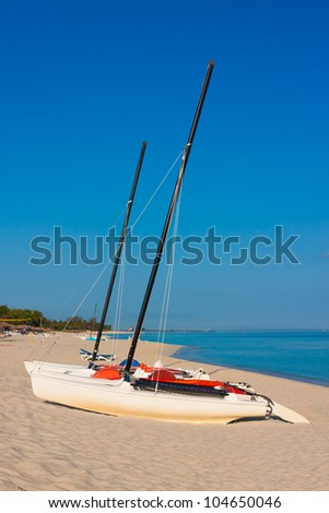 Sailing boats at a deserted beach in Cuba on a beautiful summer morning