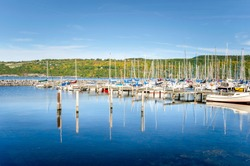 Sailing Boats in a Marina on Sunny Autumn Day ad Reflection in Water. Seneca Lake, Upstate New York