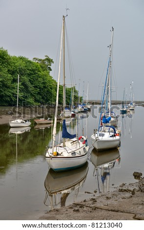 Sailing boats moored at the mouth of the River Almond, Cramond, Edinburgh, Scotland, UK