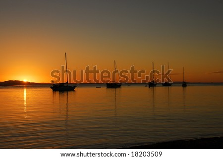 Sailing Boats Moored on the Bay at Sunset