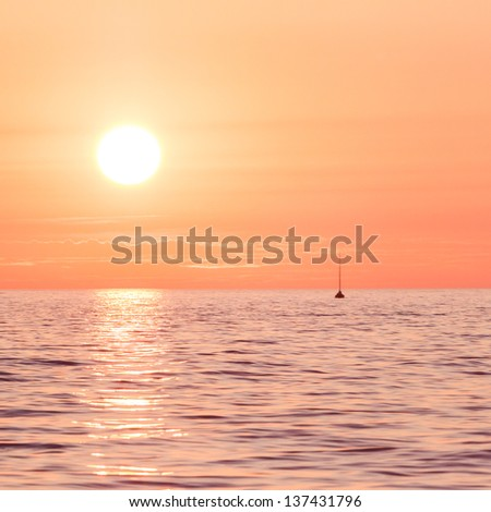 Sailing boats on a background of a beautiful red sunset
