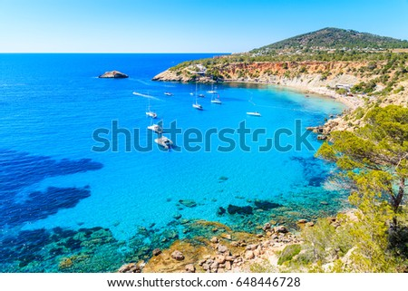 Sailing boats on Cala d'Hort bay with beautiful azure blue sea water, Ibiza island, Spain