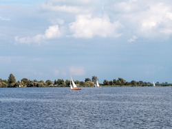 Sailing boats on Pikmeer lake in Grouw, one of Frisian lakes in Friesland, Netherlands