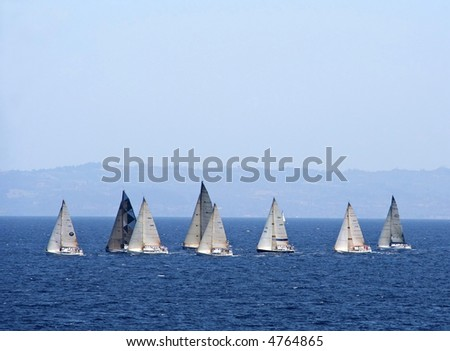 Sailing boats participating in a yacht-race in Aegean sea