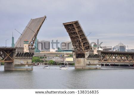 Sailing Boats passing Under an Open Drawbridge