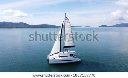 Sailing catamaran with open sails