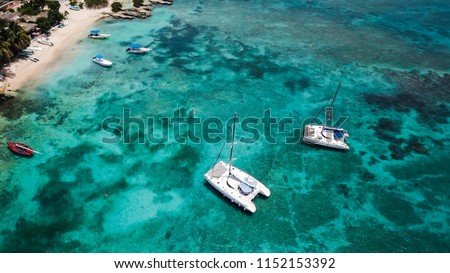 Sailing catamaran. Yachts and boats in the bay. Beautiful bay with turquoise water. View from above #1152153392