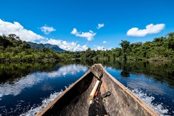 Sailing down river amidst the Amazon Jungle