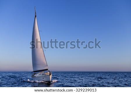 Sailing in the dusk in the Aegean sea, Greece #329239013
