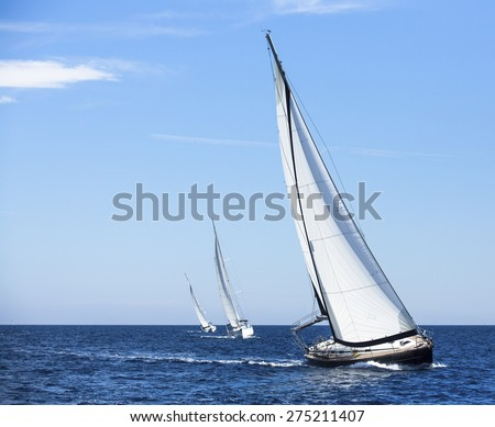 Sailing in the wind through the waves at the Aegean Sea in Greece. Luxury yachts.  #275211407