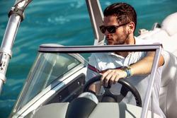 Sailing man on yacht in ocean