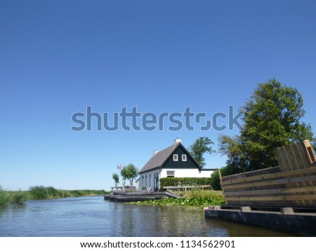 Sailing on dutch waterways, in Frisian landscape