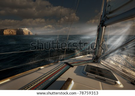 Sailing out of a storm before sunset at Cape St. Vincent, Portugal