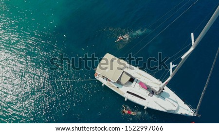 Sailing regatta, boat trip, top view. White yacht in the blue sea, drone photo. People relax on a yacht and swim in the water near the boat, sea voyage #1522997066
