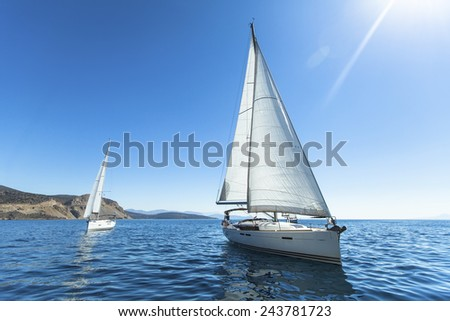 Sailing regatta. Luxury yachts. Sailing in the wind through the waves at the Aegean Sea in Greece.  #243781723