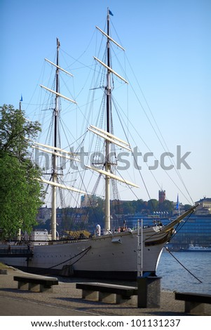 Sailing ship at dock.