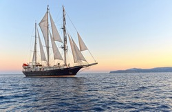 Sailing ship at sunset. Sailing. Yachting. Cruises under the sail