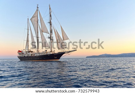 Sailing ship at sunset. Sailing. Yachting. Cruises under the sail #732579943