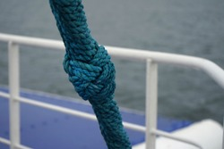 Sailing ship knob on the blue thik rope.