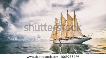 Sailing ship with sails against the background of the storm sky. Yachting. Cruise. Sailing #1069235429