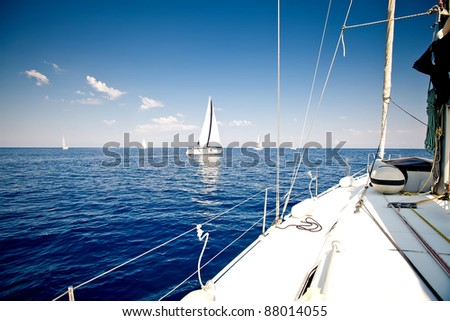 Sailing ship yacht with white sail in open sea