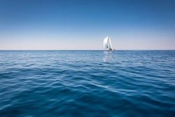 Sailing. Ship yachts with sails in the open Sea.