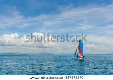 Sailing ship yachts with sails on the Sea.