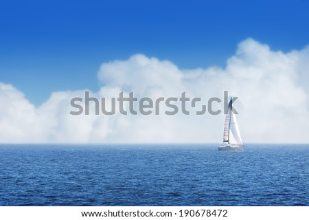 Sailing ship yachts with white sails cloudy sky