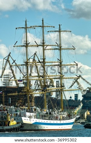 Sailing ships and towboat in the port